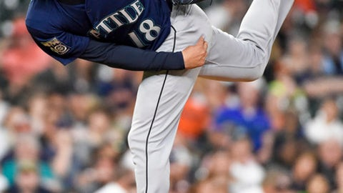 Seattle Mariners starting pitcher Hisashi Iwakuma watches a throw during the fifth inning of the team's baseball game against the Houston Astros, Tuesday, April 4, 2017, in Houston. (AP Photo/Eric Christian Smith)
