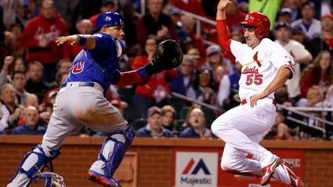 St. Louis Cardinals' Stephen Piscotty, right, scores past Chicago Cubs catcher Willson Contreras during the fifth inning of a baseball game Tuesday, April 4, 2017, in St. Louis. (AP Photo/Jeff Roberson)