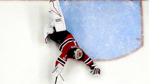 New Jersey Devils goalie Keith Kinkaid (1) dives to deflect a shot by Philadelphia Flyers center Valtteri Filppula (51), of Finland, during the third period of an NHL hockey game, Tuesday, April 4, 2017, in Newark, N.J. The Devils won 1-0 in overtime. (AP Photo/Julio Cortez)