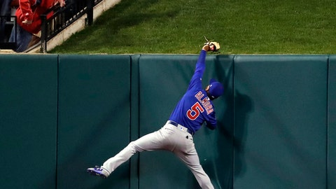 A fan watches as Chicago Cubs center fielder Albert Almora Jr. leaps to catch a ball at the wall hit by St. Louis Cardinals' Matt Adams for an out during the seventh inning of a baseball game Tuesday, April 4, 2017, in St. Louis. (AP Photo/Jeff Roberson)
