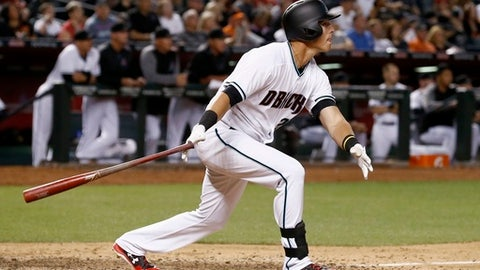 Arizona Diamondbacks' Jake Lamb watches the flight of his two-run home run against the San Francisco Giants during the fifth inning of a baseball game Tuesday, April 4, 2017, in Phoenix. (AP Photo/Ross D. Franklin)