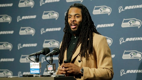 FILe - In this Jan. 7, 2017, file photo, Seattle Seahawks cornerback Richard Sherman talks to reporters following an NFL football NFC wild card playoff game against the Detroit Lions, in Seattle. Seahawks general manager John Schneider acknowledged the team has listened to trade offers regarding cornerback Richard Sherman, but downplayed that a deal may actually happen. Schneider made his comments in an interview with KIRO-AM on Wednesday, April 5, 2017. (AP Photo/Stephen Brashear, File)