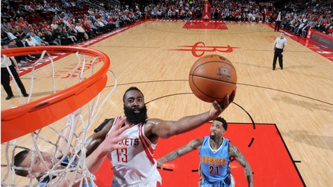 HOUSTON, TX - APRIL 5:  James Harden #13 of the Houston Rockets goes to the basket against the Denver Nuggets on April 5, 2017 at the Toyota Center in Houston, Texas. NOTE TO USER: User expressly acknowledges and agrees that, by downloading and or using this photograph, User is consenting to the terms and conditions of the Getty Images License Agreement. Mandatory Copyright Notice: Copyright 2017 NBAE (Photo by Bill Baptist/NBAE via Getty Images)