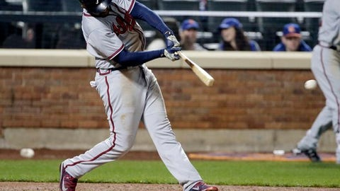 Atlanta Braves' Matt Kemp hits a two-run RBI double during the twelfth inning of a baseball game against the New York Mets, Wednesday, April 5, 2017, in New York. (AP Photo/Frank Franklin II)