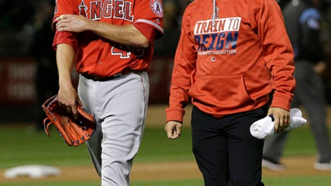 Los Angeles Angels pitcher Garrett Richards, left, leaves the field with a trainer after being relieved during the fifth inning of the team's baseball game against the Oakland Athletics in Oakland, Calif., Wednesday, April 5, 2017. (AP Photo/Jeff Chiu)