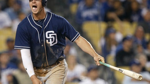 San Diego Padres' Wil Myers reacts after hitting a fly ball for an out to center against the Los Angeles Dodgers during the eighth inning of a baseball game in Los Angeles, Wednesday, April 5, 2017. (AP Photo/Alex Gallardo)