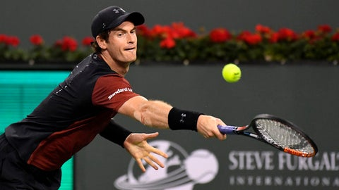 FILE - In this Saturday, March 11, 2017 file photo, Andy Murray, of Great Britain, returns a shot to Vasek Pospisil, of Canada, at the BNP Paribas Open tennis tournament in Indian Wells, Calif. France captain Yannick Noah has warned home fans against thinking the Davis Cup quarterfinal against Britain will be easier just because Andy Murray is not playing. The top-ranked Murray was Britain's inspirational leader when it won the trophy two years ago, but the three-time Grand Slam champion is nursing an elbow injury. (AP Photo/Mark J. Terrill, file)