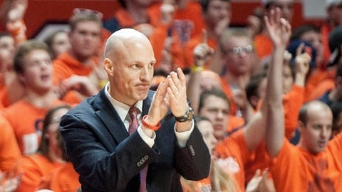 FILE - In this Jan. 25, 2017, file photo, then-Illinois coach John Groce celebrates an Illinois basket in the final minutes against Iowa during an NCAA college basketball game in Champaign, Ill. Groce has been introduced as Akron's new coach. After previously coaching at Illinois and Ohio, Groce has returned to the Mid-American Conference to the take over a program that flourished under Keith Dambrot. (AP Photo/Heather Coit, File)