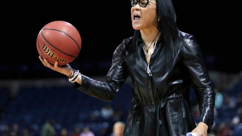 """FILE - In this March 27, 2017, file photo, South Carolina head coach Dawn Staley protest a foul during the second half of a regional final  against Florida State in the NCAA college basketball tournament in Stockton, Calif. The annual report card from The Institute for Diversity and Ethics in Sport released on Thursday, April 6, 2017, gave college sports a grade of C+ for racial hiring and a C for gender hiring. The combined grade of C+ overall for racial and gender hiring in 2016 was the lowest among all sports studies covered by the institute. Richard Lapchick, the primary author of the report and director of University of Central Florida institute, calls the report """"disheartening.""""  (AP Photo/Rich Pedroncelli, File)"""