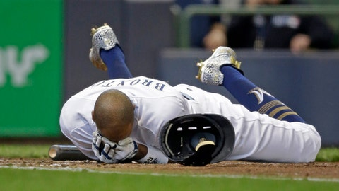 Milwaukee Brewers' Keon Broxton falls to the ground after getting hit in the helmet by Colorado Rockies starting pitcher Antonio Senzatela in the second inning of a baseball game Thursday, April 6, 2017, in Milwaukee. Broxton left the game. (AP Photo/Jeffrey Phelps)