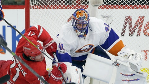 New York Islanders goalie Jaroslav Halak (41), of Slovakia, defends the goal against Carolina Hurricanes' Lee Stempniak (21) during the first period of an NHL hockey game in Raleigh, N.C., Thursday, April 6, 2017. (AP Photo/Gerry Broome)