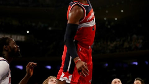 NEW YORK, NY - APRIL 06:  John Wall #2 of the Washington Wizards dunks the ball in the first half against the New York Knicks at Madison Square Garden on April 6, 2017 in New York City. NOTE TO USER: User expressly acknowledges and agrees that, by downloading and or using this Photograph, user is consenting to the terms and conditions of the Getty Images License Agreement  (Photo by Elsa/Getty Images)