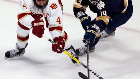 Denver's Will Butcher, left, and Notre Dame's Mike O' Leary vie for the puck during the first period of an NCAA Frozen Four men's college hockey semifinal, Thursday, April 6, 2017, in Chicago. (AP Photo/Nam Y. Huh)