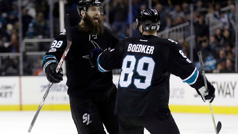 San Jose Sharks' Brent Burns, left, celebrates with Mikkel Boedker (89) after scoring against the Edmonton Oilers during the second period of an NHL hockey game Thursday, April 6, 2017, in San Jose, Calif. (AP Photo/Marcio Jose Sanchez)