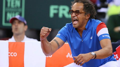Yannick Noah, headcoach of France reacts during his Davis Cup quarterfinal tennis match between France and Britain at the Kindarena Stadium of Rouen, France, Friday, April 7, 2017. (AP Photo/David Vincent)