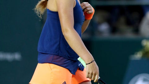 Jelena Ostapenko, of Latvia, smiles during a match against Caroline Wozniacki, of Denmark, Friday, April 7, 2017, at the Volvo Car Open tennis tournament  in Charleston, S.C. (Grace Beahm,The Post and Courier via AP)