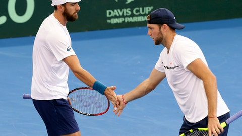 Steve Johnson, left, and Jack Sock of the U.S. react during the doubles match against Australia's Sam Groth and John Peers at the Davis Cup World Group Quarterfinal in Brisbane, Australia, Saturday, April 8, 2017. (AP Photo/Tertius Pickard)