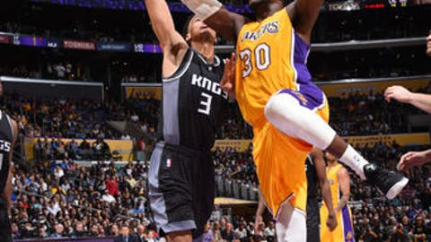 LOS ANGELES, CA - APRIL 7:  Julius Randle #30 of the Los Angeles Lakers goes up for a shot during a game against the Sacramento Kings on April 7, 2017 at STAPLES Center in Los Angeles, California. NOTE TO USER: User expressly acknowledges and agrees that, by downloading and/or using this photograph, user is consenting to the terms and conditions of the Getty Images License Agreement. Mandatory Copyright Notice: Copyright 2017 NBAE (Photo by Andrew D. Bernstein/NBAE via Getty Images)