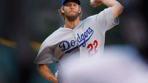 Los Angeles Dodgers starting pitcher Clayton Kershaw delivers to Colorado Rockies' DJ LeMahieu in the first inning of a baseball game Saturday, April 8, 2017, in Denver. (AP Photo/David Zalubowski)
