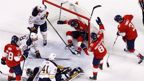 Florida Panthers center Jonathan Huberdeau (11) ends up in the net as he scores a goal against the Buffalo Sabres during the second period of an NHL hockey game, Saturday, April 8, 2017, in Sunrise, Fla. (AP Photo/Joel Auerbach)