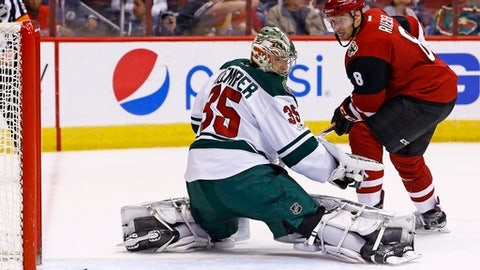 Arizona Coyotes' Tobias Rieder (8) sends a shot off the post as Minnesota Wild's Darcy Kuemper (35) looks at the puck during the second period of an NHL hockey game Saturday, April 8, 2017, in Glendale, Ariz. (AP Photo/Ross D. Franklin)