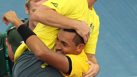 Team captain Lleyton Hewitt, top, celebrates with Nick Kyrgios of Australia after he won his match against Sam Querrey of the U.S. at the Davis Cup World Group Quarterfinal in Brisbane, Australia, Sunday, April 9, 2017. (AP Photo/Tertius Pickard)