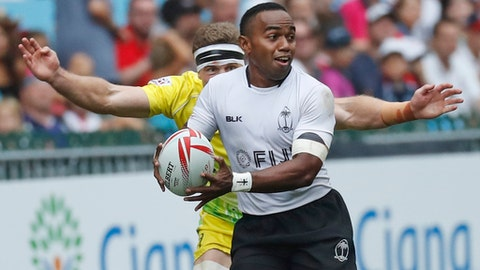 Fiji's Waisea Nacuqu, front, is tackled by Australia's Nick Malouf during the semifinal match at the Hong Kong Sevens rugby tournament in Hong Kong, Sunday, April 9, 2017. (AP Photo/Kin Cheung)