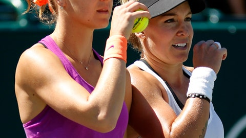 Bethanie Mattek-Sands, at right, and Lucie Safarova, from Czech Republic, left, talk strategy during their doubles final victory over Lucie Hradecka, from Czech Republic, and Katerina Siniakova, from Czech Republic, at the Volvo Car Open in Charleston, S.C., Sunday, April 9, 2017. (AP Photo/Mic Smith)