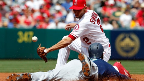 Los Angeles Angels shortstop Andrelton Simmons can't handle the throw as Seattle Mariners' Jean Segura steals second base in the first inning of a baseball game, Sunday, April 9, 2017, in Anaheim, Calif. (AP Photo/Christine Cotter)