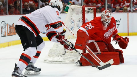 Detroit Red Wings goalie Jimmy Howard (35) stops a New Jersey Devils left wing Taylor Hall (9) shot during the first period of the final NHL hockey game at Joe Louis Arena, Sunday, April 9, 2017, in Detroit. (AP Photo/Paul Sancya)