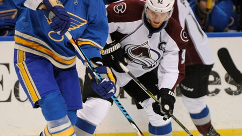 Colorado Avalanche's Gabriel Landeskog (92), of Sweden, and St. Louis Blues' Jay Bouwmeester (19) battle for the puck during the first period of an NHL hockey game, Sunday, April 9, 2017, in St. Louis. (AP Photo/Bill Boyce)