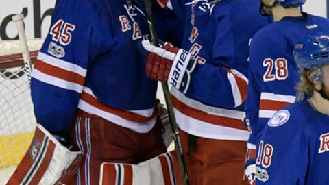 New York Rangers goalie Magnus Hellberg (45) celebrates with Rangers defenseman Brady Skjei, right, after the Rangers defeated the Pittsburgh Penguins 3-2 in an NHL hockey game, Sunday, April 9, 2017, at Madison Square Garden in New York. (AP Photo/Bill Kostroun)