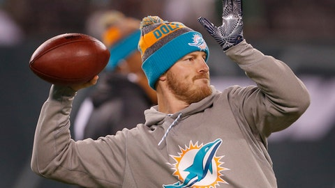Miami Dolphins quarterback T.J. Yates throws before playing in an NFL football game after the game, Saturday, Dec. 17, 2016, in East Rutherford, N.J. (AP Photo/Adam Hunger)