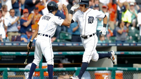 Detroit Tigers' Ian Kinsler celebrates his solo home run against the Boston Red Sox with a bat boy in the sixth inning of a baseball game in Detroit, Monday, April 10, 2017. (AP Photo/Paul Sancya)