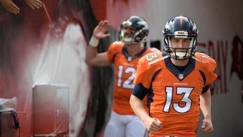 This Oct. 2, 2016 photo shows Denver Broncos quarterback Trevor Siemian (13) and quarterback Paxton Lynch (12) running onto the field for warmups before an NFL football game against the Tampa Bay Buccaneers in Tampa, Fla. Siemian won't be sitting back and watching Lynch take all the snaps at the Denver Broncos' minicamp in two weeks. Coach Vance Joseph said at the start of his team's offseason program Monday that Siemian had made a quicker-than-expected recovery from his offseason shoulder surgery. (AP Photo/Phelan M. Ebenhack)