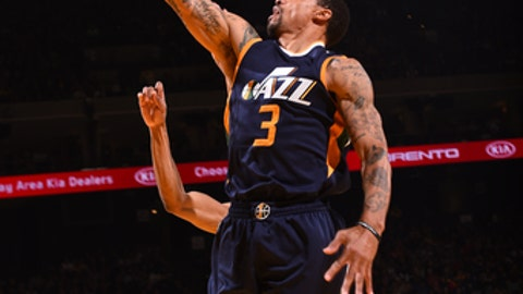 OAKLAND, CA - APRIL 10: George Hill #3 of the Utah Jazz shoots a lay up against the Golden State Warriors on April 10, 2017 at ORACLE Arena in Oakland, California. NOTE TO USER: User expressly acknowledges and agrees that, by downloading and or using this photograph, user is consenting to the terms and conditions of Getty Images License Agreement. Mandatory Copyright Notice: Copyright 2017 NBAE (Photo by Noah Graham/NBAE via Getty Images)