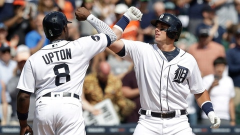 Detroit Tigers' James McCann, right, is greeted at home plate by Justin Upton after they both scored on McCann's two-run home run during the fifth inning of a baseball game against the Minnesota Twins, Tuesday, April 11, 2017, in Detroit. (AP Photo/Carlos Osorio)