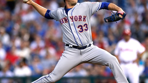 New York Mets starting pitcher Matt Harvey throws during the first inning of the team's baseball game against the Philadelphia Phillies, Tuesday, April 11, 2017, in Philadelphia. (AP Photo/Laurence Kesterson)