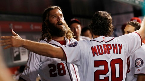 Washington Nationals left fielder Jayson Werth (28) celebrates with teammates in their dugout after hitting a home run during the fourth inning of a baseball game against the St. Louis Cardinals in Washington, Tuesday, April 11, 2017. (AP Photo/Manuel Balce Ceneta)