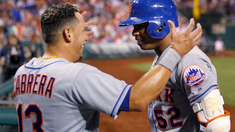 New York Mets' Yoenis Cespedes (52) is congratulated by Asdrubal Cabrera after hitting his third home run of the night, in the fifth inning of a baseball game against the Philadelphia Phillies, Tuesday, April 11, 2017, in Philadelphia. (AP Photo/Laurence Kesterson)
