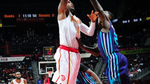 ATLANTA, GA - APRIL 11: Paul Millsap #4 of the Atlanta Hawks shoots the ball against the Charlotte Hornets during the game on April 11, 2017 at Philips Arena in Atlanta, Georgia.  NOTE TO USER: User expressly acknowledges and agrees that, by downloading and/or using this Photograph, user is consenting to the terms and conditions of the Getty Images License Agreement. Mandatory Copyright Notice: Copyright 2017 NBAE (Photo by Scott Cunningham/NBAE via Getty Images)