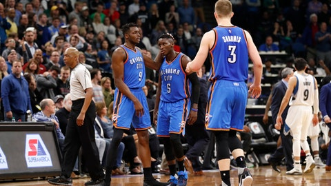 MINNEAPOLIS, MN - APRIL 11: Victor Oladipo #5 of the Oklahoma City Thunder is congratulated by his teammates after scoring the game winning basket against the Minnesota Timberwolves on April 11, 2017 at Target Center in Minneapolis, Minnesota. NOTE TO USER: User expressly acknowledges and agrees that, by downloading and or using this Photograph, user is consenting to the terms and conditions of the Getty Images License Agreement. Mandatory Copyright Notice: Copyright 2017 NBAE (Photo by Jordan Johnson/NBAE via Getty Images)