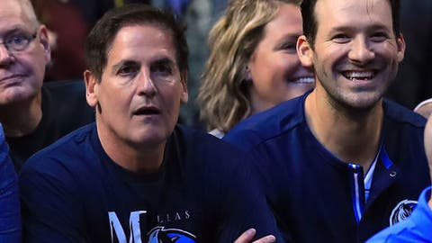 DALLAS, TX - APRIL 11:  Former NFL quarterback Tony Romo #9 of the Dallas Cowboys sits with Mark Cuban, owner of the Dallas Mavericks during a game against the Denver Nuggets at American Airlines Center on April 11, 2017 in Dallas, Texas.  NOTE TO USER: User expressly acknowledges and agrees that, by downloading and/or using this photograph, user is consenting to the terms and conditions of the Getty Images License Agreement.  (Photo by Ronald Martinez/Getty Images)