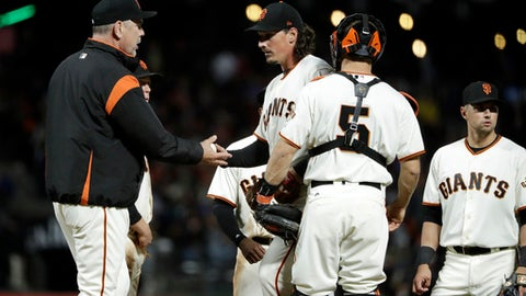 San Francisco Giants starting pitcher Jeff Samardzija, center, is pulled from the baseball game by manager Bruce Bochy, left, during the seventh inning against the Arizona Diamondbacks on Tuesday, April 11, 2017, in San Francisco. (AP Photo/Marcio Jose Sanchez)