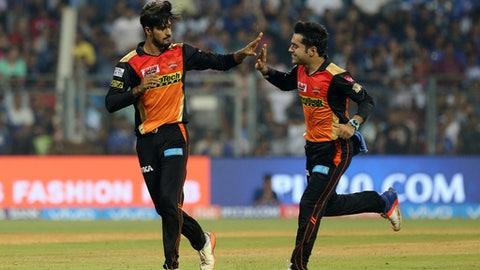 Sunrisers Hyderabads Deepak Hooda, left with Rashid Khan celebrates after Parthiv Patel's wicket during their Indian Premier League (IPL) cricket match against Mumbai Indians in Mumbai, India, Wednesday, April 12, 2017.(AP Photo/Rajanish Kakade)