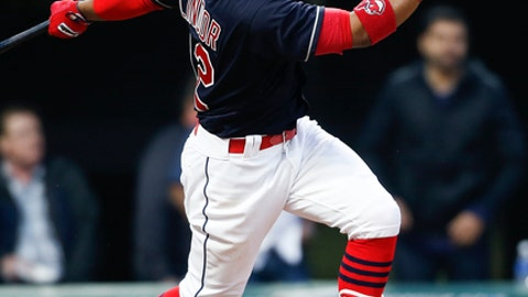 Cleveland Indians' Francisco Lindor doubles off Chicago White Sox starting pitcher Derek Holland during the sixth inning of a baseball game, Wednesday, April 12, 2017, in Cleveland. (AP Photo/Ron Schwane)