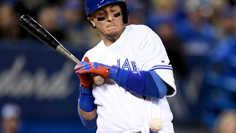 Toronto Blue Jays' Troy Tulowitzki dodges an inside pitch during the fourth inning of a baseball game against the Milwaukee Brewers in Toronto, Wednesday, April 12, 2017. (Frank Gunn/The Canadian Press via AP)