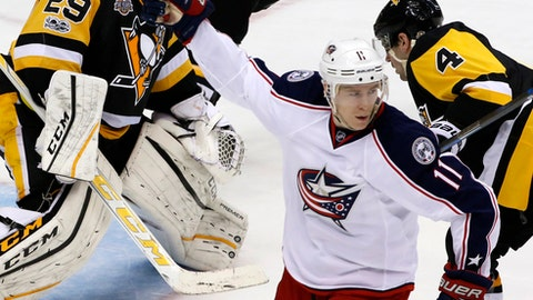 Columbus Blue Jackets' Matt Calvert (11) celebrates his goal during the third period in Game one of a first-round NHL hockey playoff series in Pittsburgh, Wednesday, April 12, 2017. The Penguins won 3-1. (AP Photo/Gene J. Puskar)