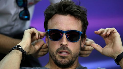 McLaren driver Fernando Alonso of Spain adjusts his earphone before the start of a news conference ahead the Bahrain Formula One Grand Prix at the Formula One Bahrain International Circuit in Sakhir, Bahrain, Thursday, April 13, 2017. The Bahrain Formula One Grand Prix will take place on Sunday. (AP Photo/Hassan Ammar)