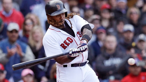 Boston Red Sox's Hanley Ramirez swings on a two-RBI double during the eighth inning of a baseball game against the Pittsburgh Pirates at Fenway Park in Boston, Thursday, April 13, 2017. The Red Sox defeated the Pirates 4-3. (AP Photo/Charles Krupa)